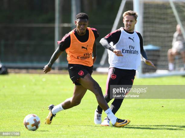 Jeff ReineAdelaide and Nacho Monreal of Arsenal during a training session at London Colney on September 13 2017 in St Albans England