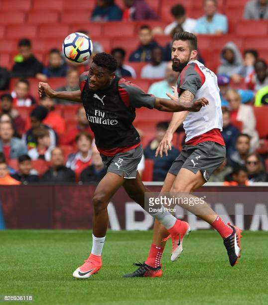 Jeff ReineAdelaide and Olivier Giroud of Arsenal during the Arsenal Training Session at Emirates Stadium on August 3 2017 in London England