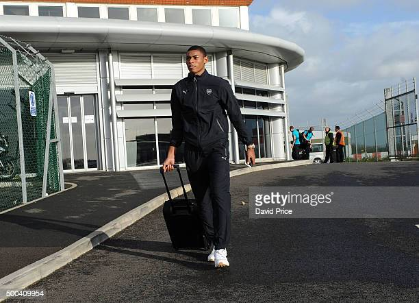 Jeff ReineAdelaide of Arsenal boards the plane at Luton Airport on December 8 2015 in Luton England