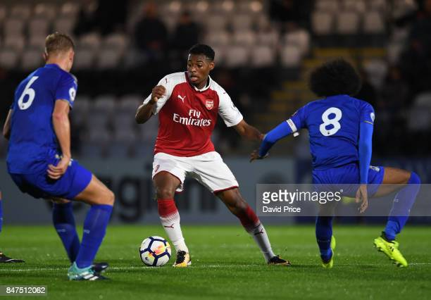 Jeff ReineAdelaide of Arsenal is closed down by Sam Hughes and Hamza Choudhury of Leicester during the match between Arsenal U23 and Leicester City...