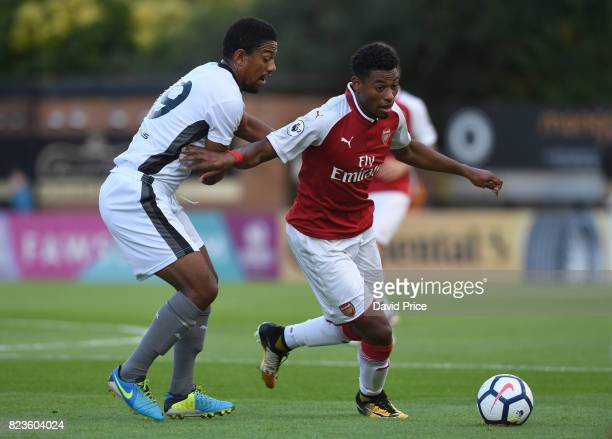 Jeff ReineAdelaide of Arsenal takes on Angelo Balenta of Boreham Wood during the match between Boreham Wood and Arsenal XI at Meadow Park on July 27...