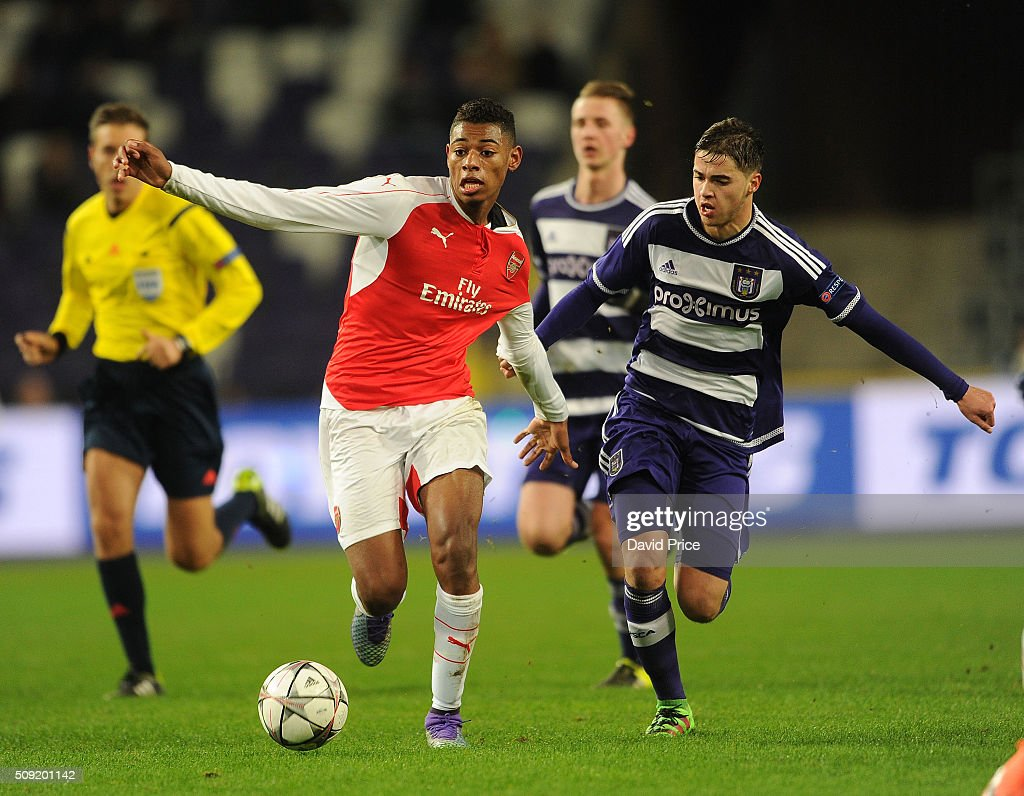 Jeff Reine-Adelaide of Arsenal takes on Samy Bourard of Anderlecht during the match between Anderlecht and Arsenal at Constant Vanden Stock Stadium on February 9, 2016 in Brussels, Bruxelles-Capitale, Region de.