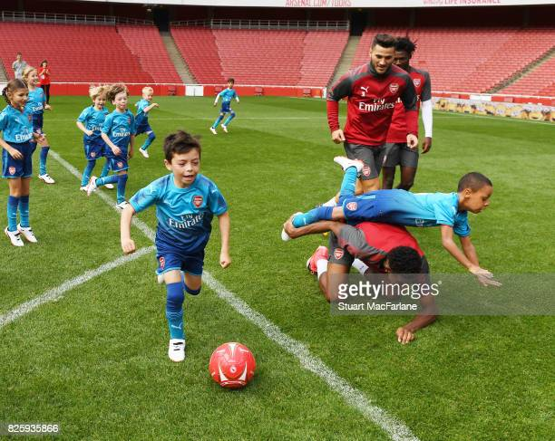 Jeff ReineAdelaide takes on a group of young fans as the Arsenal 1st team take on the Jnr Gunners after a training session at Emirates Stadium on...