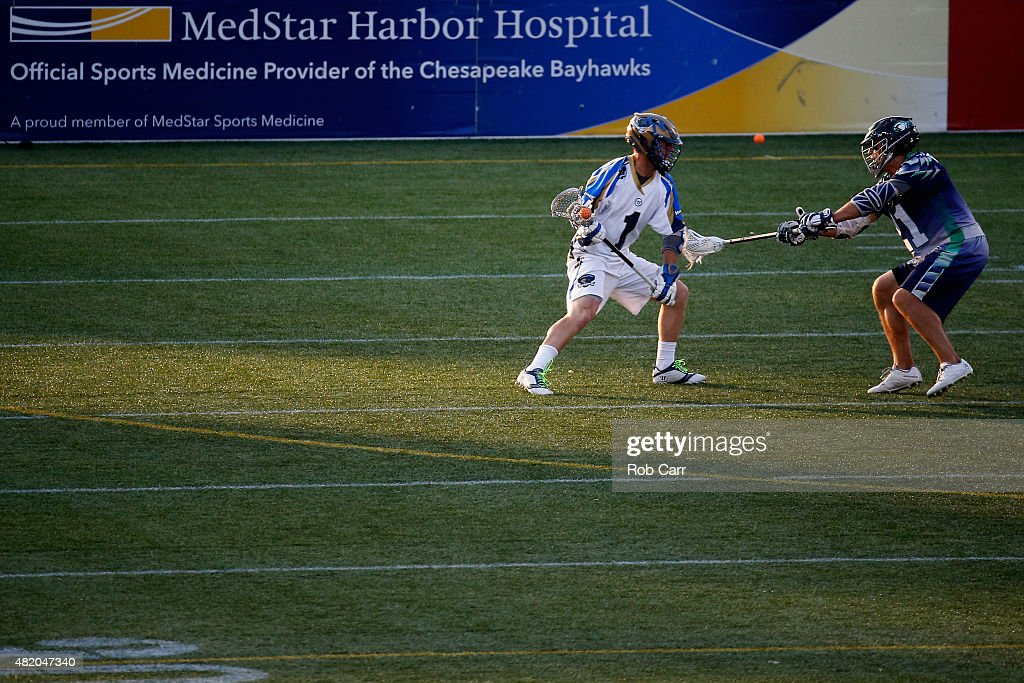 Jeff Reynolds of the Chesapeake Bayhawks defends against Mike Chanenchuk of the Charlotte Hounds during the first half at NavyMarine Corps Memorial...