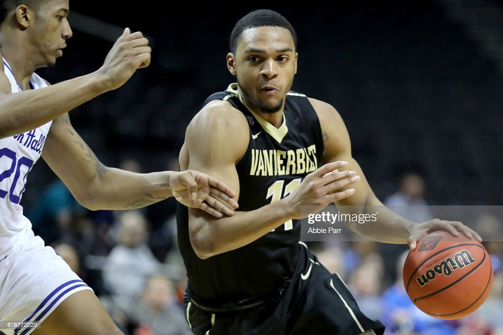 Jeff Roberson #11 of the Vanderbilt Commodores drives to the basket against Desi Rodriguez #20 of the Seton Hall Pirates in the second half during their NIT Season Tip Off tournament game at Barclays Center on November 24, 2017 in the Brooklyn brough of New York City.