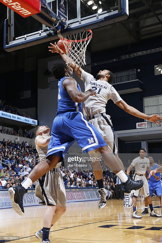 Jeff Robinson #21 of the Xavier Musketeers blocks a shot against Tarik Black #10 of the Memphis Tigers during the game at Cintas Center on February 26, 2013 in Cincinnati, Ohio. Xavier defeated Memphis 64-62.