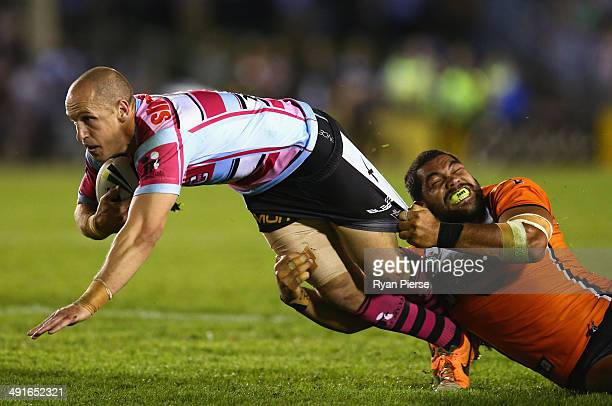 Jeff Robson of the Sharks is tackled by Adam Blair of the Tigers during the round 10 NRL match between the CronullaSutherland Sharks and the Wests...