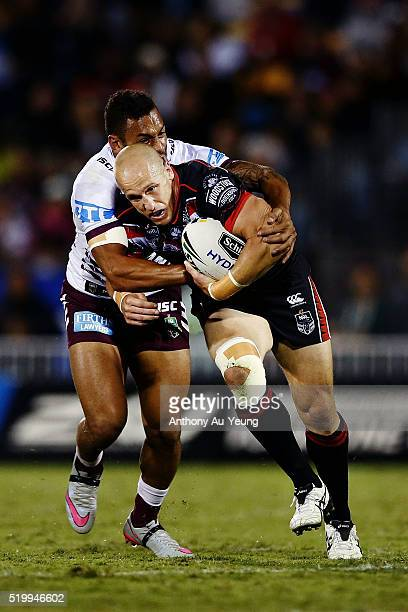 Jeff Robson of the Warriors is tackled by Apisai Koroisau of the Sea Eagles during the round six NRL match between the New Zealand Warriors and the...