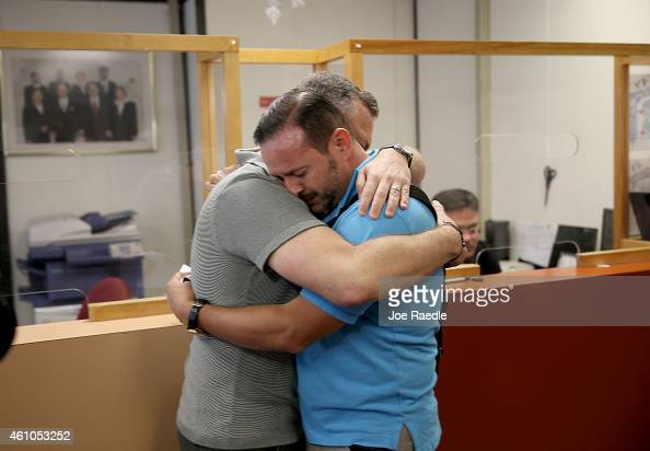 Jeff Ronci and Juan Talavera are embrace as they arrive at the Clerk of the Courts MiamiDade County Court to obtain their marriage license after the...