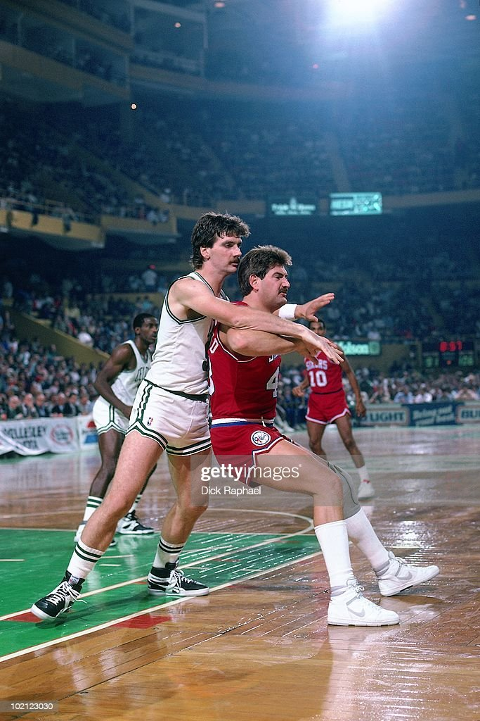 Jeff Ruland #42 of the Philadelphia 76ers posts up against the Boston Celtics during a game played in 1987 at the Boston Garden in Boston, Massachusetts.