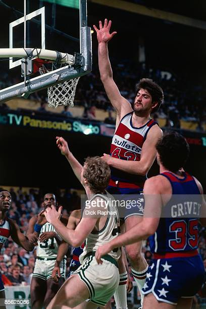 Jeff Ruland of the Washington Bullets goes for the rebound against Larry Bird of the Boston Celtics during a game played in 1982 at the Boston Garden...