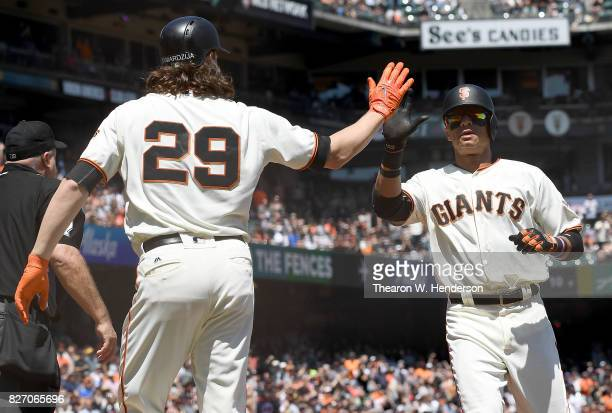 Jeff Samardzija and Gorkys Hernandez of the San Francisco Giants celebrates after they both scored on a bases loaded tworun RBI single from Hunter...