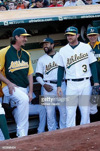 Jeff Samardzija Coco Crisp and Craig Gentry of the Oakland Athletics stand in the dugout prior to the game against the San Francisco Giants at Oco...