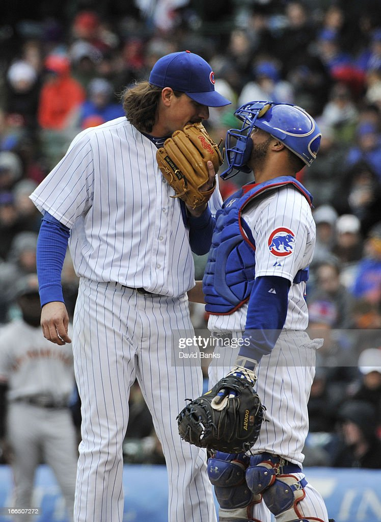 <a gi-track='captionPersonalityLinkClicked' href=/galleries/search?phrase=Jeff+Samardzija&family=editorial&specificpeople=2106748 ng-click='$event.stopPropagation()'>Jeff Samardzija</a> #29 of the Chicago Cubs talks with his catcher <a gi-track='captionPersonalityLinkClicked' href=/galleries/search?phrase=Welington+Castillo&family=editorial&specificpeople=4959193 ng-click='$event.stopPropagation()'>Welington Castillo</a> #53 during the fifth inning of a game against the San Francisco Giants on April 13, 2013 at Wrigley Field in Chicago, Illinois.