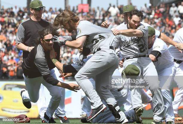 Jeff Samardzija of the San Francisco Giants goes after Bryce Harper of the Washington Nationals after Harper charged the mound from being hit by a...