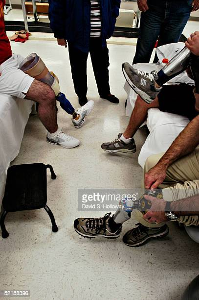 Jeff Sanders left of Millmont PA and USMC Cpl Corey Webb of Springville AL upper right compares his prostetic leg with that of Disabled American...