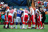 Jeff Saturday of the Green Bay Packers huddles with the AFC team against the National Football Conference team during the 2013 Pro Bowl at Aloha...
