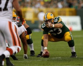 Jeff Saturday of the Green Bay Packers prepares to snap the ball against the Cleveland Browns during a preseason game at Lambeau Field on August 16...