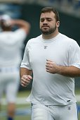 Jeff Saturday of the Indianapolis Colts warms up before a game against the Philadelphia Eagles on November 10 2002 at Veterans Stadium in...