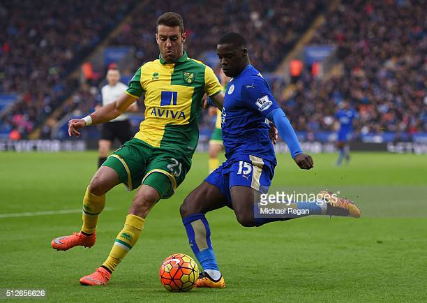 Jeff Schlupp of Leicester City and Ivo Pinto of Norwich City compete for the ball during the Barclays Premier League match between Leicester City and...