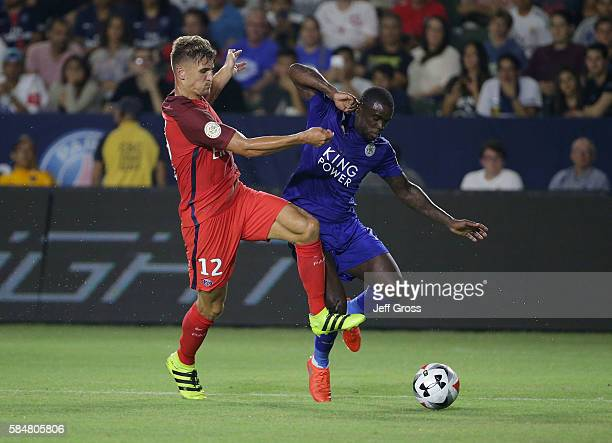 Jeff Schlupp of Leicester City is challenged by Thomas Meunier of Paris SaintGermain in the first half during the 2016 International Champions Cup at...