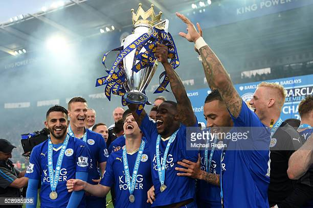 Jeff Schlupp of Leicester City lifts the Premier League Trophy as players and staffs celebrate the season champion after the Barclays Premier League...
