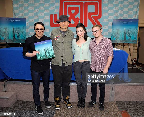 Jeff Schroeder Billy Corgan Nicole Fiorentino and Mike Byrne of Smashing Pumpkins sign copies of their new CD 'Oceania' on June 20 2012 in New York...