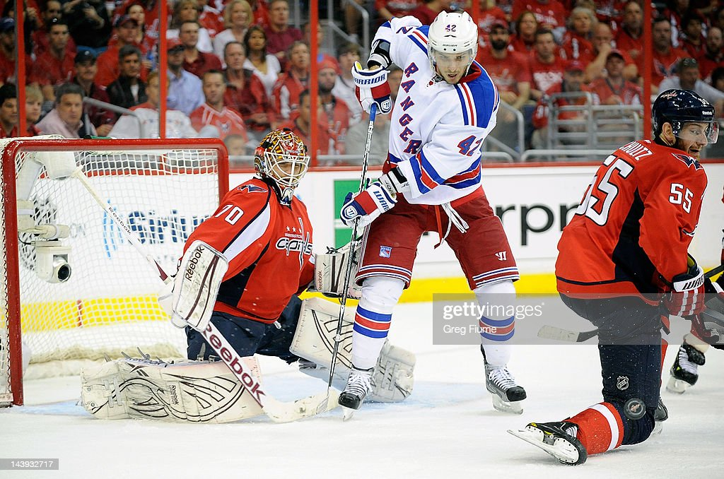 Jeff Schultz #55 of the Washington Capitals blocks a shot in front of <a gi-track='captionPersonalityLinkClicked' href=/galleries/search?phrase=Artem+Anisimov&family=editorial&specificpeople=543215 ng-click='$event.stopPropagation()'>Artem Anisimov</a> #42 of the New York Rangers in Game Four of the Eastern Conference Semifinals during the 2012 NHL Stanley Cup Playoffs at the Verizon Center on May 5, 2012 in Washington, DC.