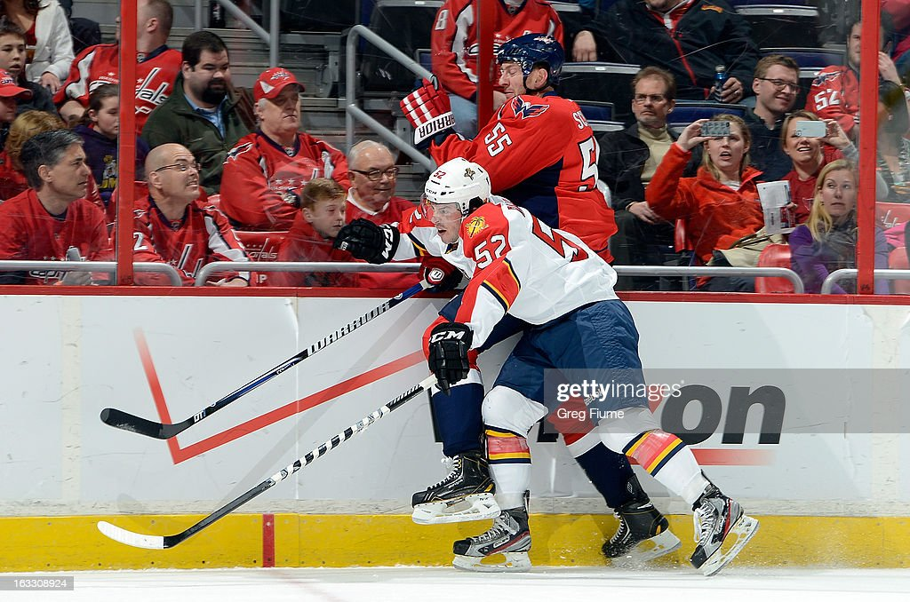 Jeff Schultz #55 of the Washington Capitals is checked by Jonathan Rheault #52 of the Florida Panthers at the Verizon Center on March 7, 2013 in Washington, DC.