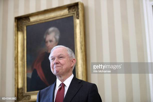 Jeff Sessions listens as US President Donald Trump introduces him prior to being sworn in as the new US Attorney General in the Oval Office of the...