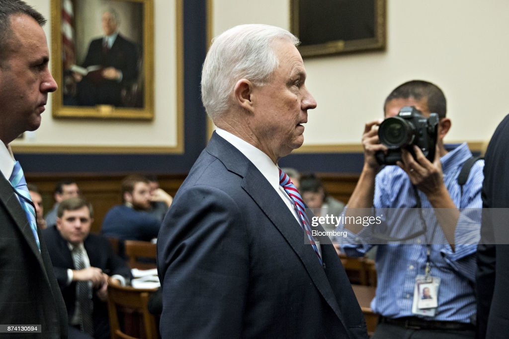 Jeff Sessions, U.S. attorney general, center, exits during a break in the House Judiciary Committee hearing in Washington, D.C., U.S., on Tuesday, Nov. 14, 2017. Sessions denied he lied or misled Congress about contacts with Russia by people involved in Donald Trump's presidential campaign. Photographer: Andrew Harrer/Bloomberg via Getty Images