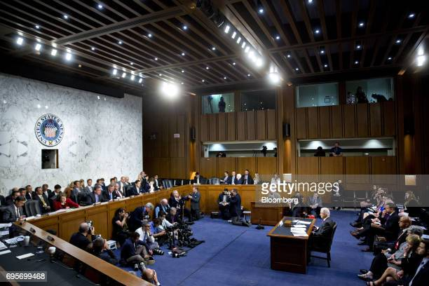 Jeff Sessions US attorney general right listens during a Senate Intelligence Committee hearing in Washington DC US on Tuesday June 13 2017 While...