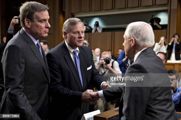 Jeff Sessions US attorney general right shakes hands with Senator Richard Burr a Republican from North Carolina and chairman of the Senate...
