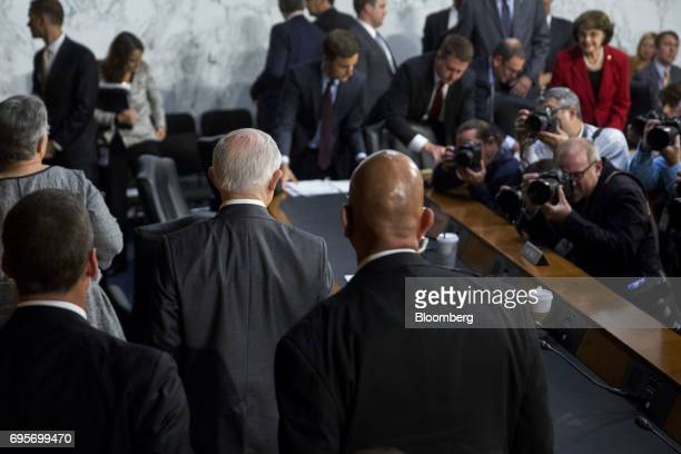 Jeff Sessions US attorney general second from left walks out after a Senate Intelligence Committee hearing in Washington DC US on Tuesday June 13...