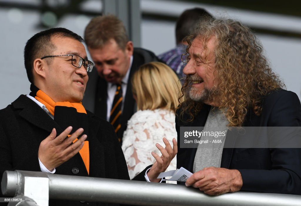 Jeff Shi of Fosun and Wolverhampton Wanderers speaks with Robert Plant from Led Zeppelin during the Sky Bet Championship match between Burton Albion and Wolverhampton at Pirelli Stadium on September 30, 2017 in Burton-upon-Trent, England.