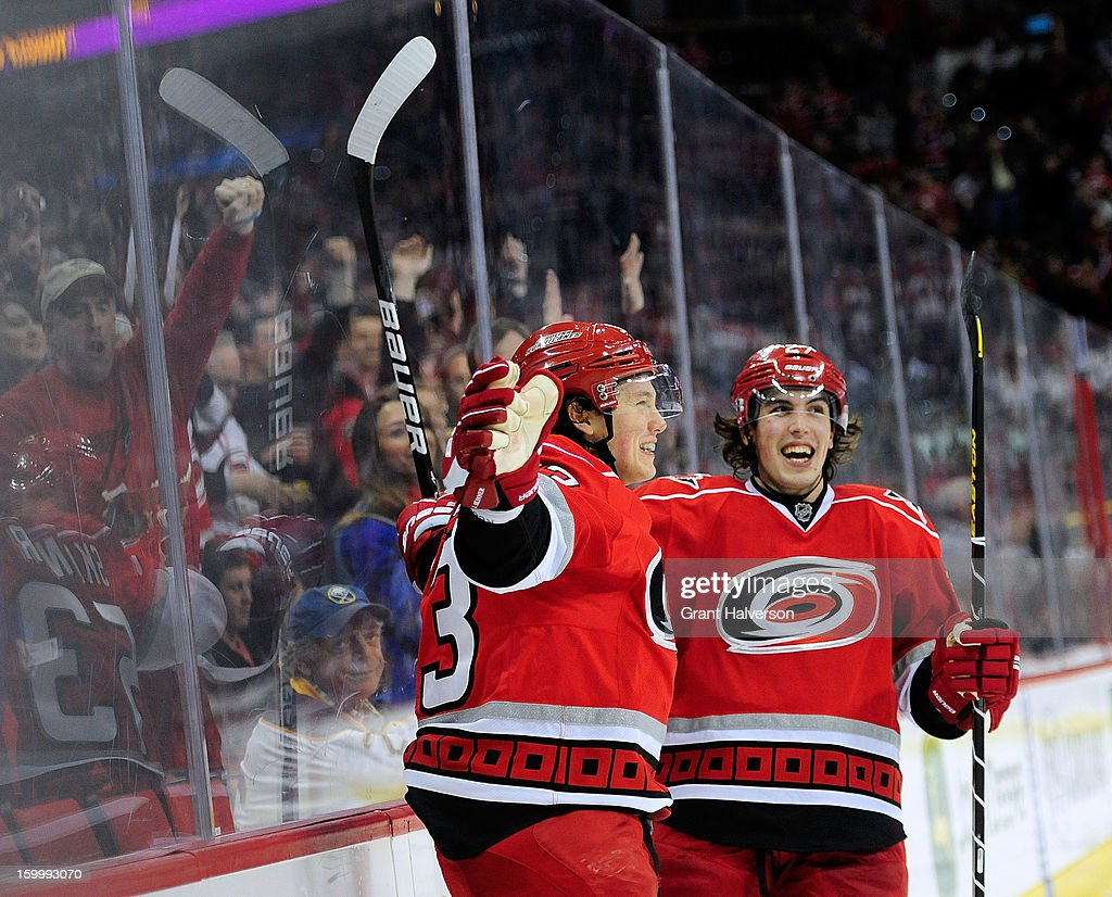 Jeff Skinner #53 and Justin Faulk #27 of the Carolina Hurricanes celebrate after Skinner's goal against the Buffalo Sabres during the second period at PNC Arena on January 24, 2013 in Raleigh, North Carolina.