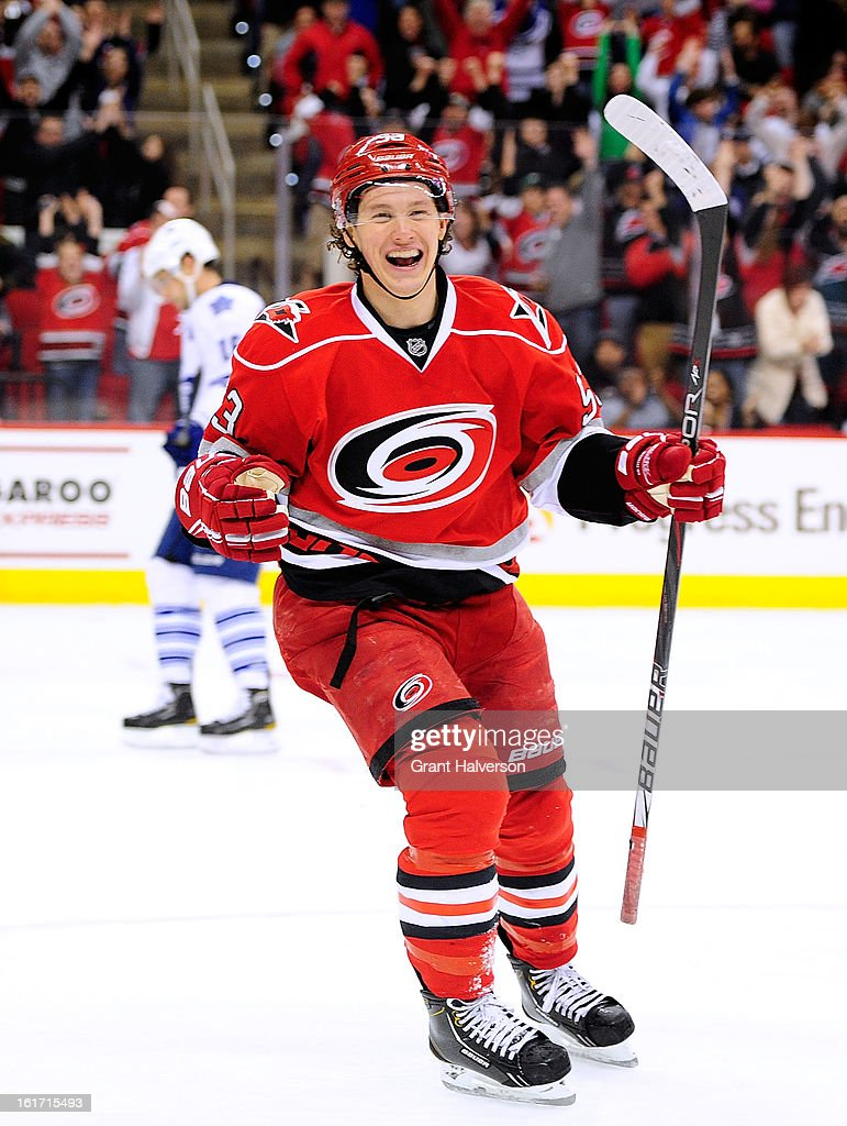 Jeff Skinner #53 celebrates after assisting on a goal by teammate Jordan Staal #11 of the Carolina Hurricanes against the Toronto Maple Leafs in the second period at PNC Arena on February 14, 2013 in Raleigh, North Carolina.