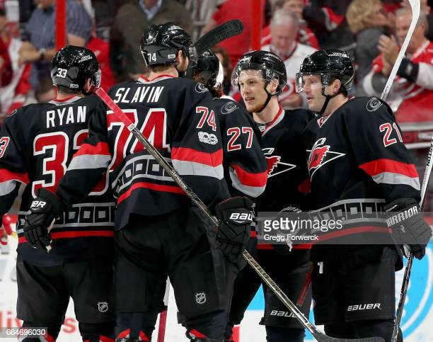 Jeff Skinner of the Carolina Hurricanes and teammates Jaccob Slavin Derek Ryan and Lee Stempniak celebrate a goal against the Detroit Red Wings...