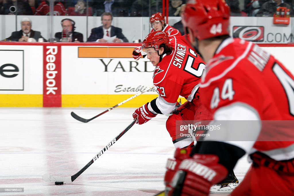 Jeff Skinner #53 of the Carolina Hurricanes carries the puck across center ice between teammates Zac Dalpe #22 and Jay Harrison #44 during their NHL game against the Boston Bruinson January 28, 2013 at PNC Arena in Raleigh North Carolina.