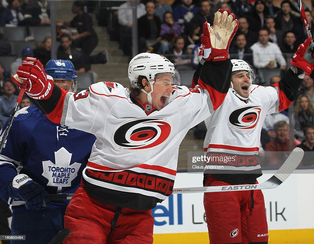 Jeff Skinner #53 of the Carolina Hurricanes celebrates a goal by teammate Jordan Staal #11 in a game against the Toronto Maple Leafs on February 4, 2013 at the Air Canada Centre in Toronto, Canada. The Hurricanes defeated the Leafs 4-1.
