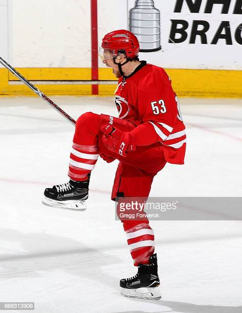 Jeff Skinner of the Carolina Hurricanes celebrates after scoring in the 3rd period during an NHL game against the Sy Louis Blues on April 8 2017 at...