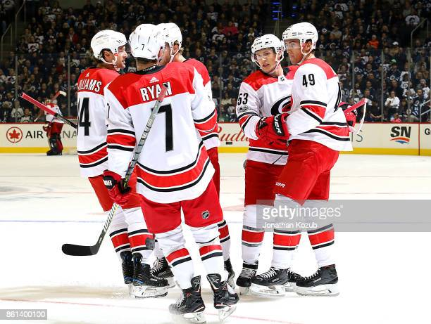 Jeff Skinner of the Carolina Hurricanes celebrates his first period goal against the Winnipeg Jets with teammates Justin Williams Derek Ryan Noah...