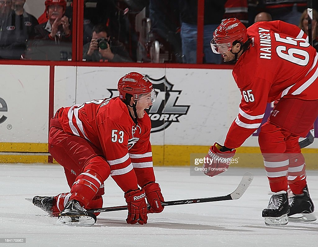 <a gi-track='captionPersonalityLinkClicked' href=/galleries/search?phrase=Jeff+Skinner&family=editorial&specificpeople=3147596 ng-click='$event.stopPropagation()'>Jeff Skinner</a> #53 of the Carolina Hurricanes celebrates his game-tying goal with teammate <a gi-track='captionPersonalityLinkClicked' href=/galleries/search?phrase=Ron+Hainsey&family=editorial&specificpeople=206345 ng-click='$event.stopPropagation()'>Ron Hainsey</a> #65 during an NHL game on October 11, 2013 at PNC Arena in Raleigh, North Carolina.