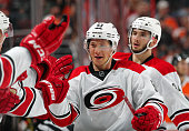Jeff Skinner of the Carolina Hurricanes celebrates his third period goal against the Philadelphia Flyers with his teammates on the bench on December...