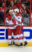 Jeff Skinner of the Carolina Hurricanes celebrates with teammate Elias Lindholm after scoring a goal in the second period against the Washington...