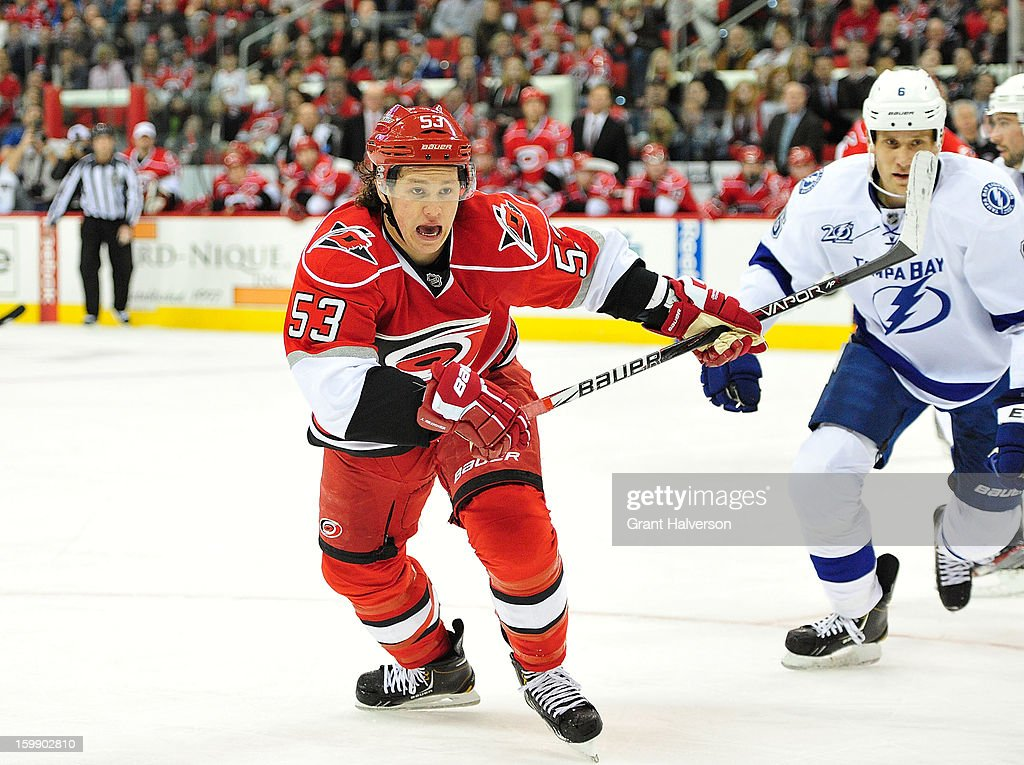 Jeff Skinner #53 of the Carolina Hurricanes chases the puck during play against the Tampa Bay Lightning at PNC Arena on January 22, 2013 in Raleigh, North Carolina.
