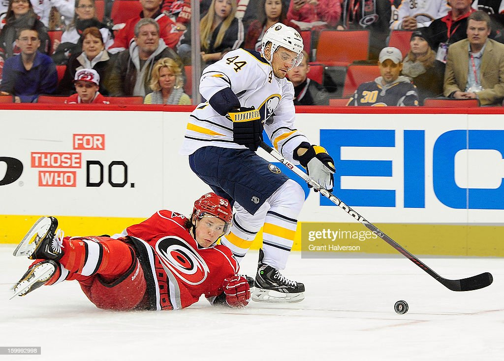 Jeff Skinner #53 of the Carolina Hurricanes collides with Andrej Sekera #44 of the Buffalo Sabres during play at PNC Arena on January 24, 2013 in Raleigh, North Carolina.