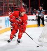Jeff Skinner of the Carolina Hurricanes controls the puck behind the net and looks to pass the puck in the crease during their NHL game against the...