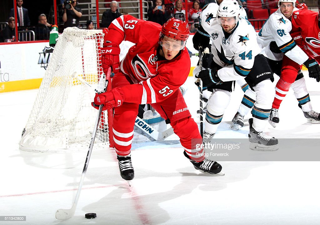 Jeff Skinner of the Carolina Hurricanes controls the puck near the net as MarcEdouard Vlasic of the San Jose Sharks defends during an NHL game at PNC...