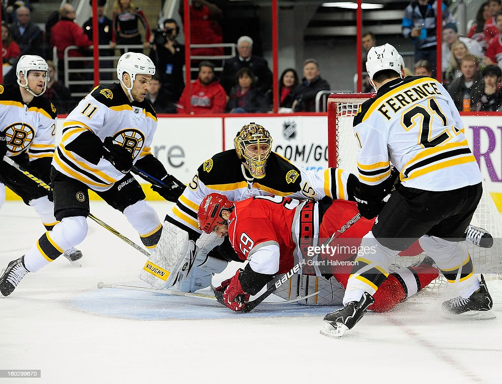 Jeff Skinner #53 of the Carolina Hurricanes crashes into goalkeeper Anton Khudobin #35 of the Boston Bruins as he drives to the net during play at PNC Arena on January 28, 2013 in Raleigh, North Carolina.